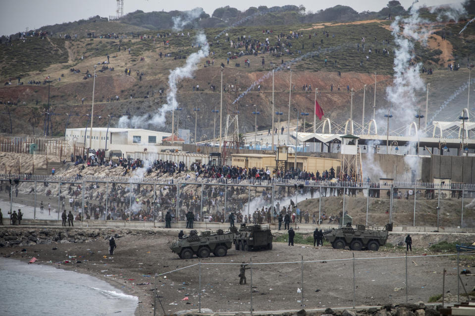 Spanish Army and Guardia Civil officers take positions next to the border of Morocco and Spain, at the Spanish enclave of Ceuta, on Tuesday, May 18, 2021. (AP Photo/Javier Fergo)