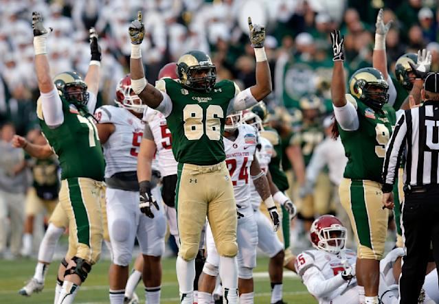 Colorado State tight end Kivon Cartwright (86) celebrates with teammates as the game winning field goal is made against Washington State during the second half of the NCAA New Mexico Bowl college football game, Saturday, Dec. 21, 2013, in Albuquerque, N.M. Colorado State won 48-45.(AP Photo/Matt York)