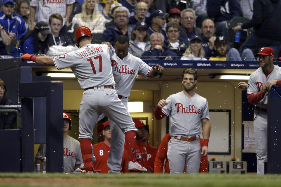 Philadelphia Phillies' Rhys Hoskins (17) celebrates with Jean Segura after hitting a solo home run during the seventh inning of the team's baseball game against the Milwaukee Brewers on Friday, May 24, 2019, in Milwaukee. (AP Photo/Aaron Gash)