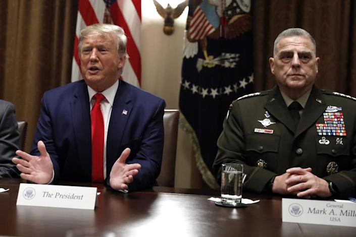 President Donald Trump speaks as the Chairman of the Joint Chiefs of Staff Gen. Mark Milley, right, listens during a briefing with senior military leaders in the Cabinet Room at the White House in Washington, Monday, Oct. 7, 2019. (AP Photo/Carolyn Kaster)