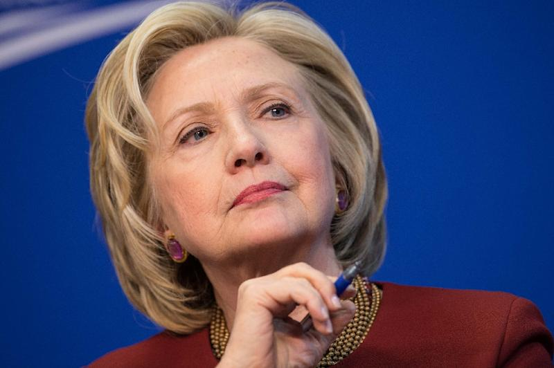Hillary Clinton is expected to finally announce her White House candidacy Sunday, empowering her to parry Republican attacks as she seeks to become the United States' first female president (AFP Photo/Nicholas Kamm)