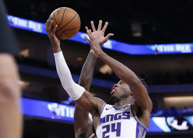 n this photo taken Oct. 10, 2019, Sacramento Kings guard Buddy Hield goes to the basket during the second half of an NBA preseason basketball game against the Phoenix Suns in Sacramento, Calif. Hield, who was acquired when the Kings sent DeMarcus Cousins to the New Orleans Pelicans, led the team in scoring last season averaging 20.7 points per game. (AP Photo/Rich Pedroncelli)