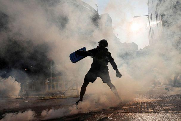 PHOTO:A protester throws an object during a demonstration on China's National Day, in Wong Tai Sin, Hong Kong, Oct. 1, 2019. (Tyrone Siu/Reuters)