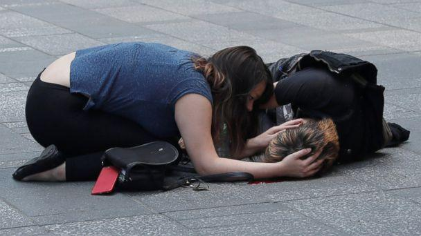 PHOTO: A woman attends to an injured man on the sidewalk in Times Square after a speeding vehicle struck pedestrians on the sidewalk in New York City, May 18, 2017. (Mike Segar/Reuters )