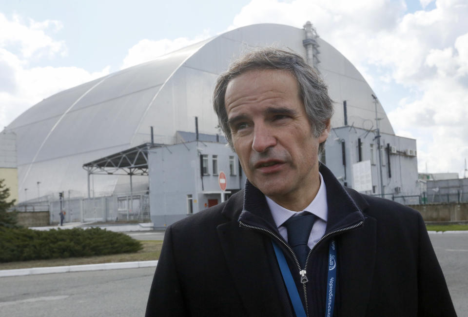FILE - In this April 27, 2021 file photo, Director general of the International Atomic Energy Agency, Rafael Mariano Grossi in front of a shelter construction which covers the exploded reactor at the Chernobyl nuclear plant, in Chernobyl,Ukraine. Speaking at a news conference in Vienna Monday, May 24, 2021, Grossi said that Iran has agreed to a one-month extension to the deal on surveillance cameras at nuclear sites. (AP Photo/Efrem Lukatsky, File)