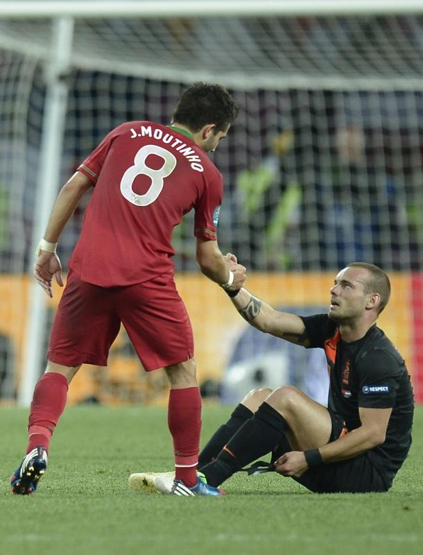 Portuguese midfielder Joao Moutinho (L) commisserates with Dutch midfielder Wesley Sneijder at the end the Euro 2012 football championships match Portugal vs. Netherlands, on June 17, 2012 at the Metalist stadium in Kharkiv. AFP PHOTO / FILIPPO MONTEFORTEFILIPPO MONTEFORTE/AFP/GettyImages