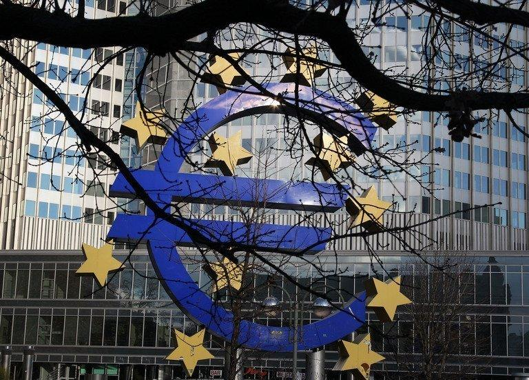 The Euro logo is seen in front of the European Central Bank, in Frankfurt/Main,  December 6, 2012