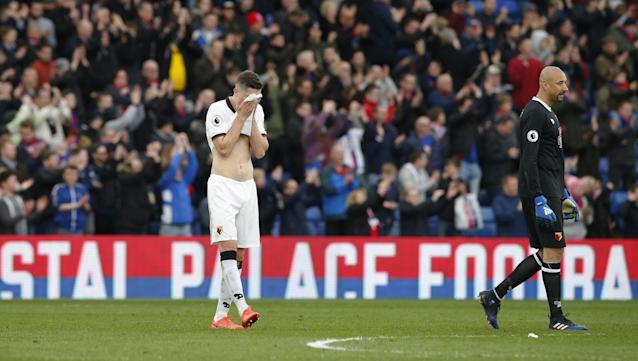 <p>Watford's Craig Cathcart looks dejected after the game </p>