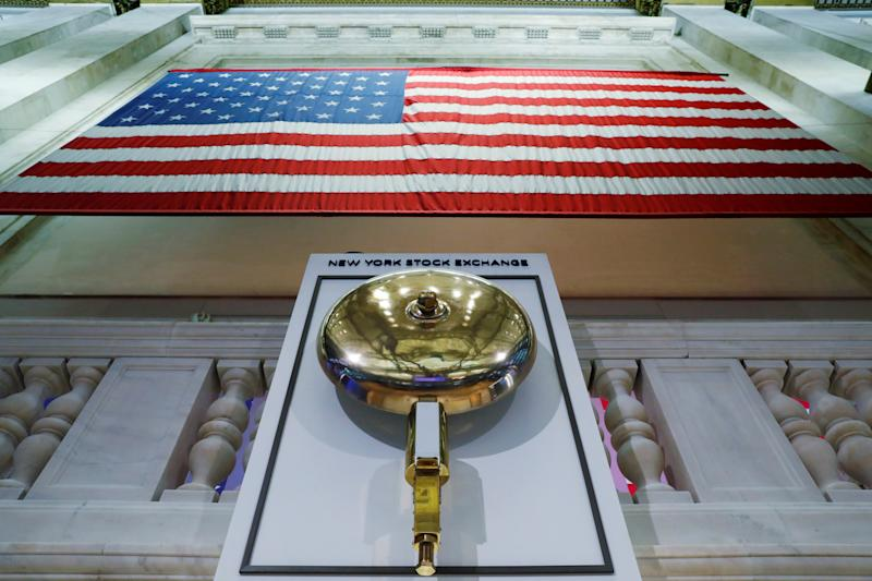 The bell used to open and close the markets hangs in front of an empty podium above the floor of the New York Stock Exchange (NYSE) as it prepares to close due to the coronavirus disease (COVID-19) outbreak in New York, U.S., March 20, 2020. REUTERS/Lucas Jackson TPX IMAGES OF THE DAY