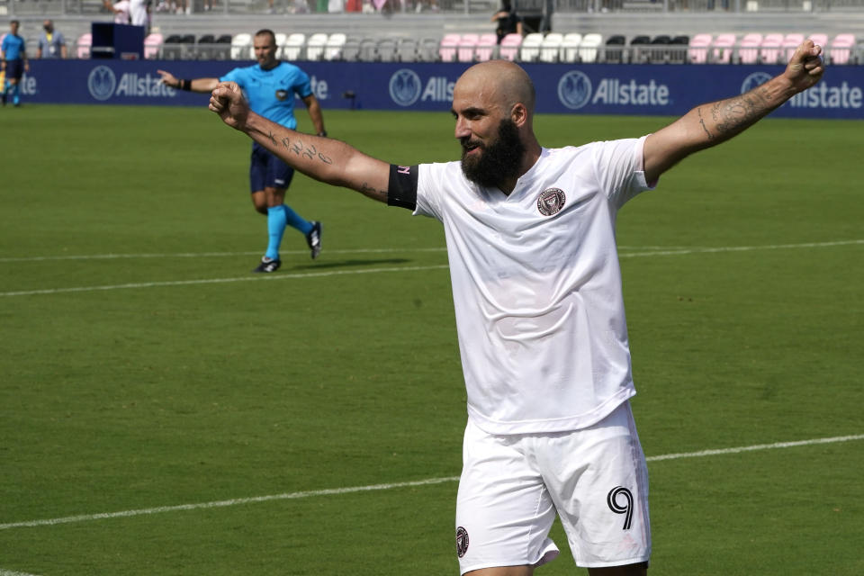 Inter Miami forward Gonzalo Higuain (9) celebrates after an asset on a goal scored by forward Robbie Robinson during the first half of an MLS soccer match against LA Galaxy, Sunday, April 18, 2021, in Fort Lauderdale, Fla. (AP Photo/Lynne Sladky)
