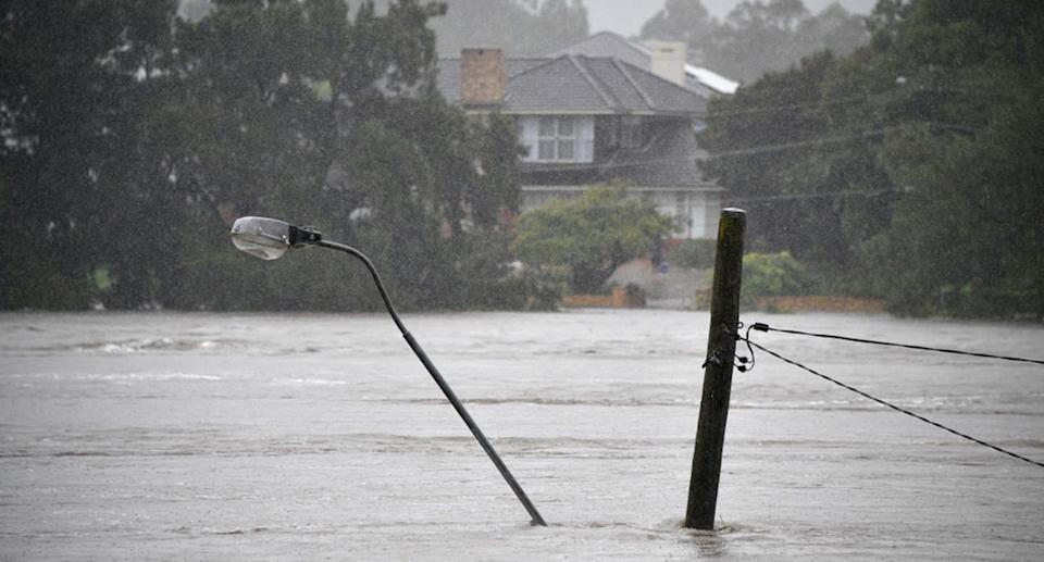A street light pole under floodwaters along the overflowing Nepean river in Penrith suburb on March 21, 2021.