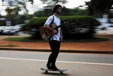 A man rolls on a skateboard at Ibirapuera Park in Sao Paulo, Brazil, April 24, 2015. REUTERS/Nacho Doce