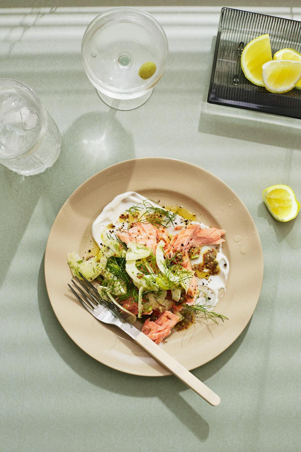 """This is entrée recipe you want to serve to guests when you have no time to cook and have no desire to turn on the oven. Hot-smoked salmon is sold wherever you purchase gravlax and other cured fish; in the supermarket it's probably stocked alongside packages of smoked trout. <a href=""""https://www.bonappetit.com/recipe/hot-smoked-salmon-with-salted-yogurt-and-fennel?mbid=synd_yahoo_rss"""" rel=""""nofollow noopener"""" target=""""_blank"""" data-ylk=""""slk:See recipe."""" class=""""link rapid-noclick-resp"""">See recipe.</a>"""
