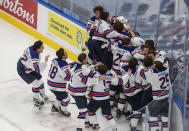 U.S. players celebrate a win over Canada in the championship game in the IIHF World Junior Hockey Championship, Tuesday, Jan. 5, 2021, in Edmonton, Alberta. (Jason Franson/The Canadian Press via AP)