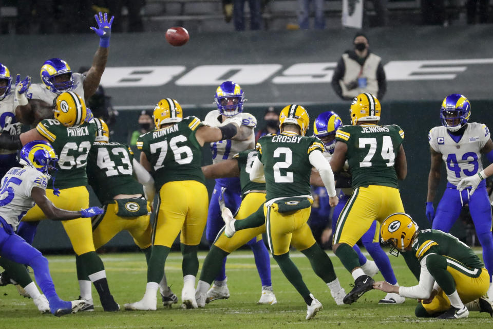 Green Bay Packers kicker Mason Crosby kicks a 39-yard field goal against the Los Angeles Rams during the first half of an NFL divisional playoff football game, Saturday, Jan. 16, 2021, in Green Bay, Wis. (AP Photo/Mike Roemer)