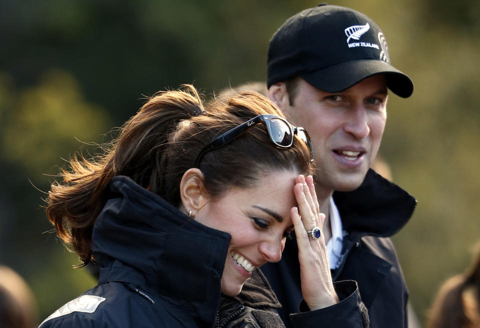 Catherine, Duchess of Cambridge, and her husband, Britain's Prince William, laugh before taking a jet-boat ride on the Shotover River in Queenstown April 13, 2014. Prince William and his wife are undertaking a 19-day official visit to New Zealand and Australia with their son, Prince George. REUTERS/Phil Noble (NEW ZEALAND - Tags: ROYALS SOCIETY)