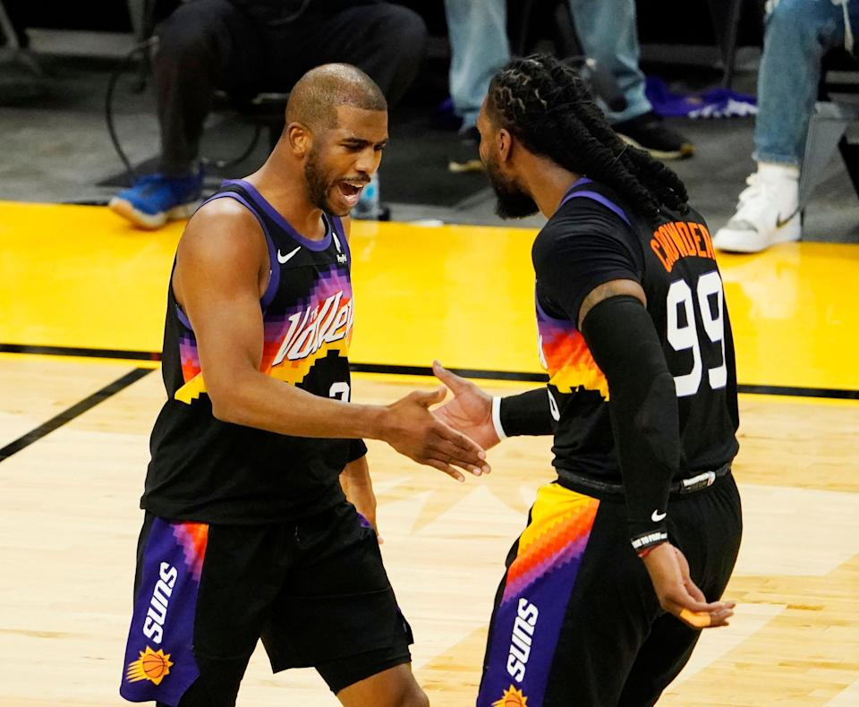 Jun 9, 2021; Phoenix, Arizona, USA; Phoenix Suns guard Chris Paul (3) celebrates with forward Jae Crowder (99) against the Denver Nuggets during game two in the second round of the 2021 NBA Playoffs at Phoenix Suns Arena. Mandatory Credit: Rob Schumacher-Arizona Republic