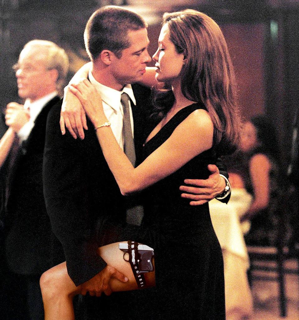 """<p>Brad Pitt and Angelina Jolie <a href=""""http://www.etonline.com/news/198514_angelina_jolie_brad_pitt_timeline"""" rel=""""nofollow noopener"""" target=""""_blank"""" data-ylk=""""slk:meet"""" class=""""link rapid-noclick-resp"""">meet</a> on the set of <em>Mr. and Mrs. Smith, </em>and sparks fly/explode all over the place—specifically, all over Pitt's marriage. Jolie later described falling for Brad while filming the movie during an <a href=""""http://people.com/celebrity/angelina-jolie-how-brad-pitt-i-fell-in-love/"""" rel=""""nofollow noopener"""" target=""""_blank"""" data-ylk=""""slk:interview"""" class=""""link rapid-noclick-resp"""">interview</a> with <em>Vogue:</em></p><p>""""Because of the film we ended up being brought together to do all these crazy things, and I think we found this strange friendship and partnership that kind of just suddenly happened. I think a few months in I realized, 'God, I can't wait to get to work.' Whether it was shooting a scene or arguing about a scene or gun practice or dance class or doing stunts—anything we had to do with each other, we just found a lot of joy in it together and a lot of real teamwork. We just became kind of a pair. And it took until, really, the end of the shoot for us, I think, to realize that it might mean something more than we'd earlier allowed ourselves to believe. And both knowing that the reality of that was a big thing, something that was going to take a lot of serious consideration.""""</p>"""