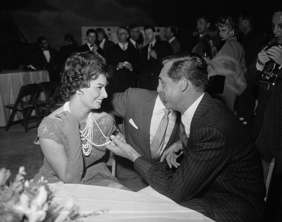 """<p>While filming <em>The Pride and the Passion</em> with Sophia Loren in Spain, Grant <a href=""""https://www.independent.co.uk/news/obituaries/betsy-drake-actress-and-writer-who-married-cary-grant-introducing-him-to-lsd-and-survived-the-a6739956.html"""" rel=""""nofollow noopener"""" target=""""_blank"""" data-ylk=""""slk:became infatuated with the Italian actress"""" class=""""link rapid-noclick-resp"""">became infatuated with the Italian actress</a> and even proposed—while still married. Drake visited the set and, on her return from Spain, had to be rescued at sea when her ocean liner collided with another ship. Grant remained in Spain despite the accident.</p>"""