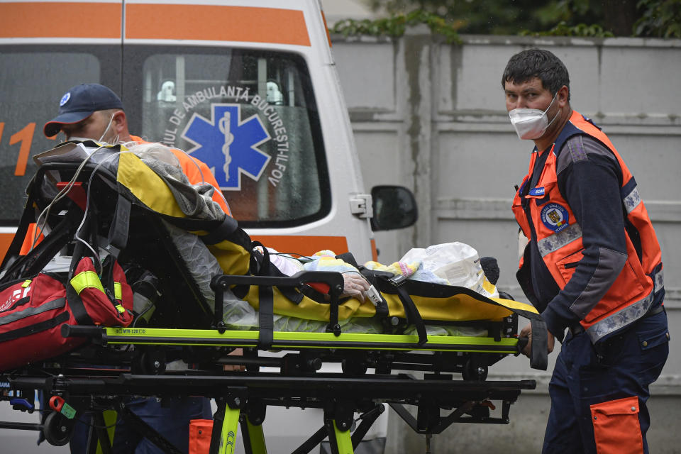 Paramedics bring an elderly patient to the emergency room, turned into a CODIV-19 unit due the high number of cases, at the Bagdasar-Arseni hospital in Bucharest, Romania, Tuesday, Oct. 12, 2021. Romania reported on Tuesday nearly 17,000 new COVID-19 infections and 442 deaths, the highest number of coronavirus infections and deaths in a day since the pandemic started, as the nation's health care system struggles to cope with an acute surge of new cases.(AP Photo/Andreea Alexandru)