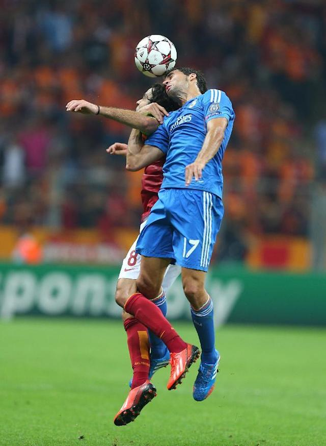 Alvaro Arbeloa of Real Madrid, foreground, vies for the ball with Selcuk Inan of Galatasaray, during the Champions League Group B soccer match, in Istanbul, Turkey, Tuesday, Sept. 17, 2013. (AP Photo)