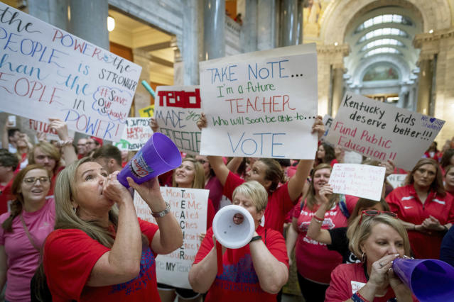 <p>Teachers from across Kentucky gather inside the state Capitol to rally for increased funding for education, Friday, April 13, 2018, in Frankfort, Ky. (Photo: Bryan Woolston/AP) </p>