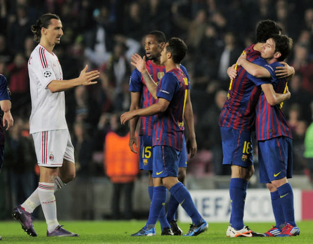 AC Milan's Swedish forward Zlatan Ibrahimovic (L) shakes hands with FC Barcelona players at the end of the Champions League quarter-final second leg football match FC Barcelona vs AC Milan on April 3, 2012 at Camp Nou stadium in Barcelona. FC Barcelona defeated AC Milan 3-1 to reach the semi-finals. AFP PHOTO / JOSEP LAGO