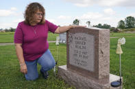 Sharon Grover looks at the grave of her daughter, Rachael, Tuesday, Sept. 28, 2021, in Mesopotamia, Ohio. Grover believes her daughter started using prescription painkillers around 2013 but missed any signs of her addiction as her daughter, the oldest of five children, remained distanced. (AP Photo/Tony Dejak)