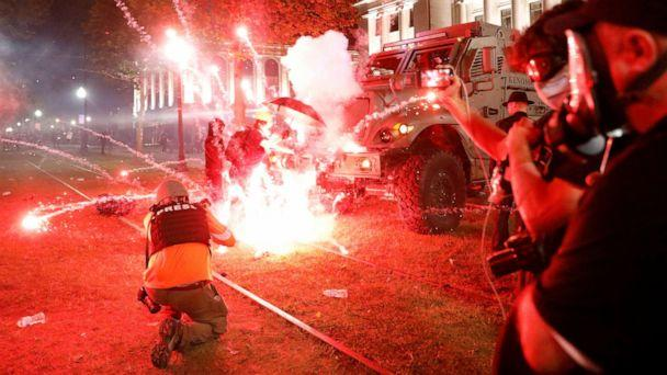PHOTO: Flares go off in front of a Kenosha Country Sheriff Vehicle as demonstrators take part in a protest following the police shooting of Jacob Blake, a Black man, in Kenosha, Wis., Aug. 25, 2020. (Brendan Mcdermid/Reuters)