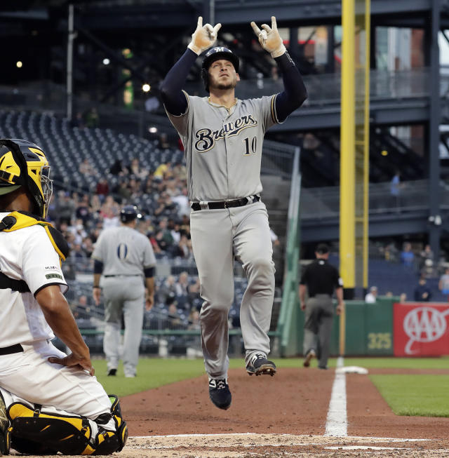 Milwaukee Brewers' Yasmani Grandal celebrates as he is about to cross home plate after hitting a solo home run off Pittsburgh Pirates starting pitcher Joe Musgrove during the third inning of a baseball game in Pittsburgh, Thursday, May 30, 2019. (AP Photo/Gene J. Puskar)