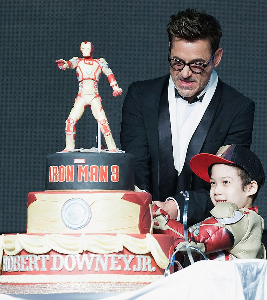 SEOUL, SOUTH KOREA - APRIL 04:  Actor Robert Downey Jr. cuts his 48th birthday cake with a fan during the 'Iron Man 3' South Korea Premiere at Times Square on April 4, 2013 in Seoul, South Korea. Robert Downey Jr. is visiting South Korea to promote his recent film 'Iron Man 3' which will be released on April 25 in South Korea.  (Photo by Han Myung-Gu/WireImage)