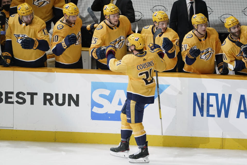 Nashville Predators center Nick Cousins (21) celebrates after scoring a goal against the Carolina Hurricanes during the third period in Game 4 of an NHL hockey Stanley Cup first-round playoff series Sunday, May 23, 2021, in Nashville, Tenn. (AP Photo/Mark Humphrey)
