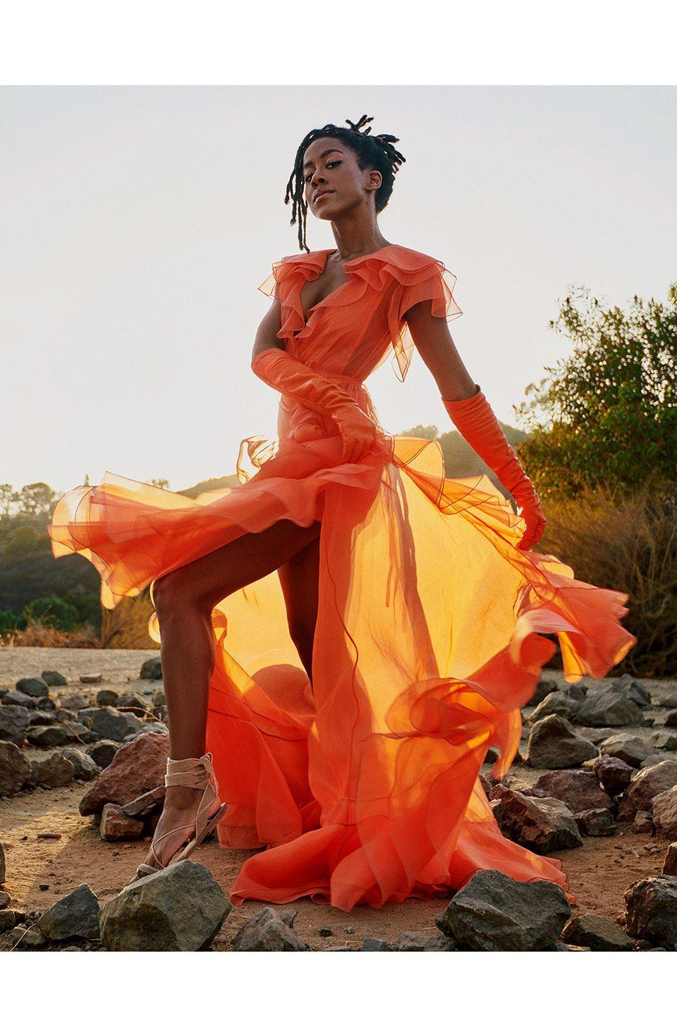 <p><strong>10 October </strong>Tomi Adeyemi made a statement in a vibrant Valentino gown and matching gloves. </p>