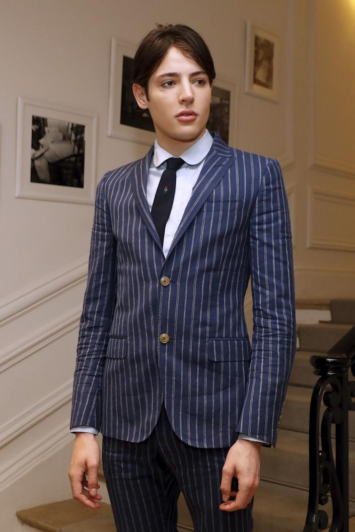 Harry Brant poses before Christian Dior 2016-2017 fall/winter Haute Couture collection fashion show on July 4, 2016 in Paris. (AFP / PATRICK KOVARIK via Getty Images)