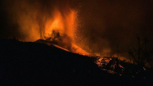 Lava from the Cumbre Vieja volcano has been pouring downhill since Sunday's eruption, devastating everything in its path. Local officials said about 100 houses have been destroyed so far. AP