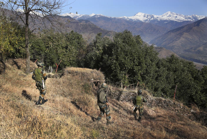 Indian army soldiers patrol near a forward post at the Line of Control (LOC) that divides the region between the two nuclear-armed rivals of India and Pakistan, in Poonch, about 248 kilometers (155 miles) from Jammu, India, Wednesday, Dec. 16, 2020. Tens of thousands of soldiers from India and Pakistan are positioned along the two sides. The apparent calm is often broken by the boom of blazing guns, with each side accusing the other of initiating the firing. (AP Photo/Channi Anand)