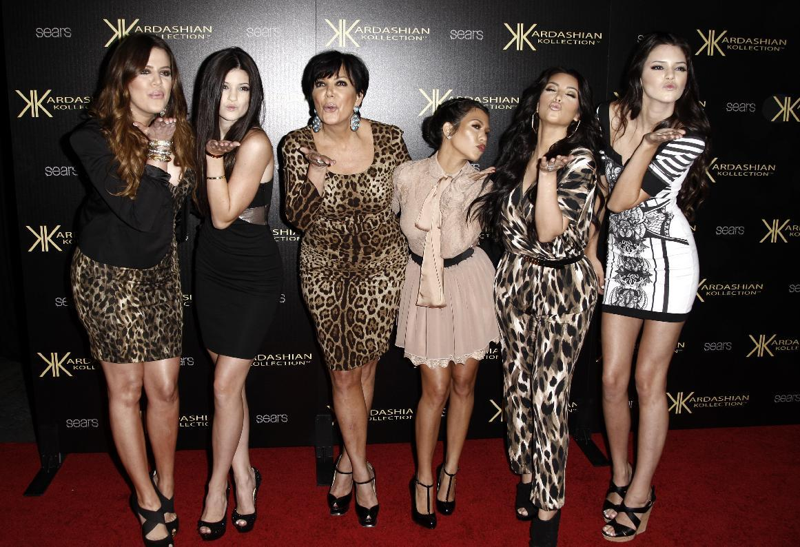 """FILE - In this Aug. 17, 2011 file photo, from left, Khloe Kardashian, Kylie Jenner, Kris Jenner, Kourtney Kardashian, Kim Kardashian, and Kendall Jenner arrive at the Kardashian Kollection launch party in Los Angeles. The E! Entertainment network said Tuesday it had reached a deal with its most bankable franchise to make three more seasons of """"Keeping Up With the Kardashians."""" (AP Photo/Matt Sayles, file)"""