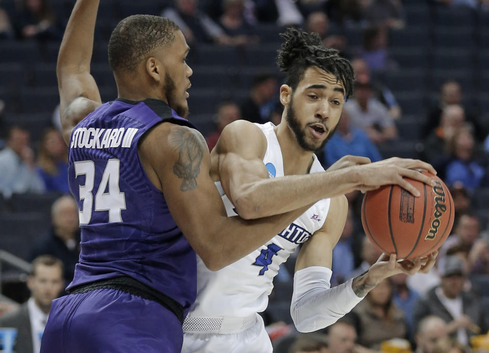 Creighton's Ronnie Harrell Jr (4) drives against Kansas State's Levi Stockard III (34) during the first half of a first-round game in the NCAA men's college basketball tournament in Charlotte, N.C., Friday, March 16, 2018. (AP Photo/Bob Leverone)