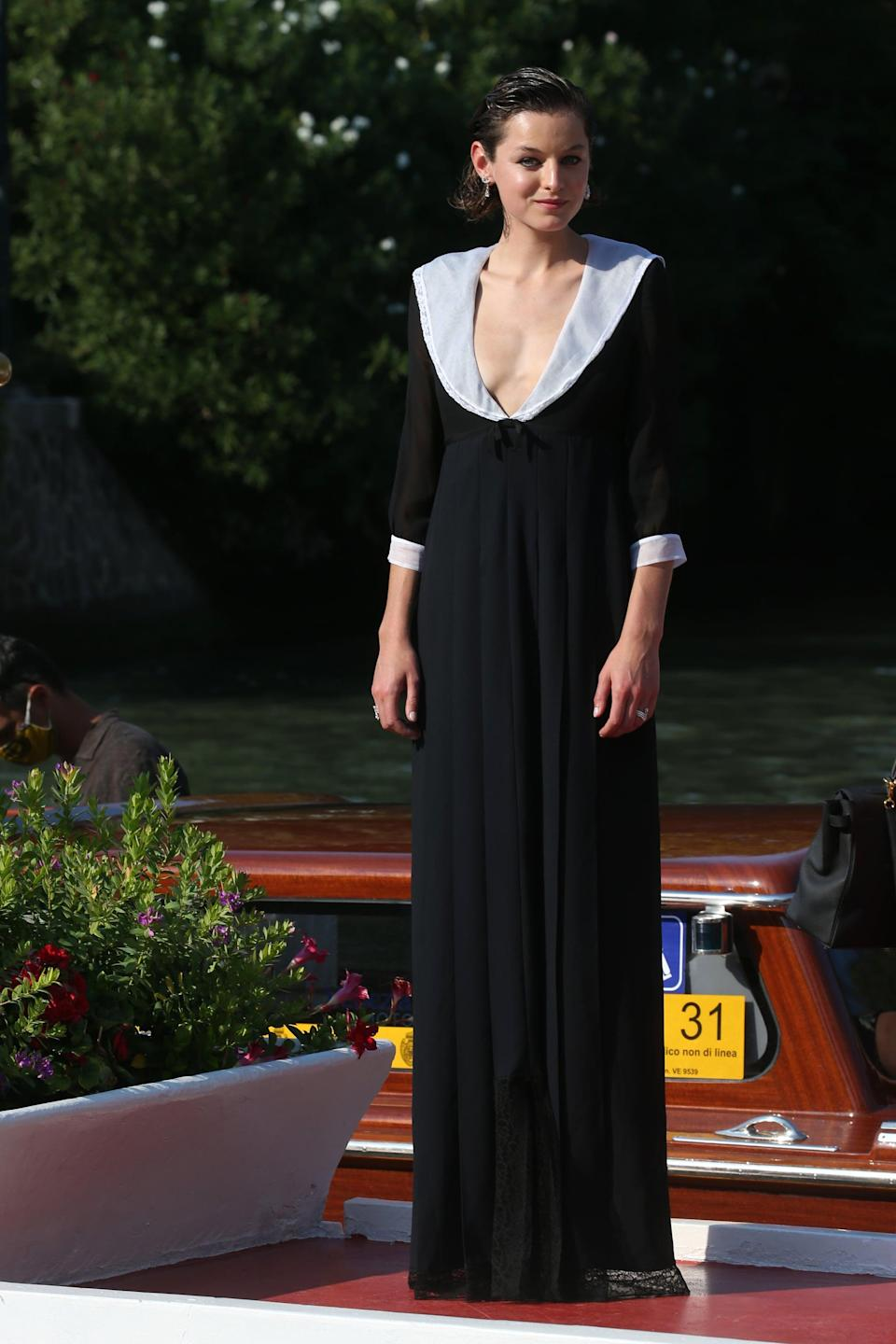 <p>Emma Corrin wore a black maxi dress with a contrasting white Peter Pan collar and cuffs to the 2020 Venice Film Festival.</p>