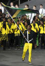 Jamaica's Usain Bolt carries the flag during the Opening Ceremony at the 2012 Summer Olympics, Friday, July 27, 2012, in London. (AP Photo/Jae C. Hong)