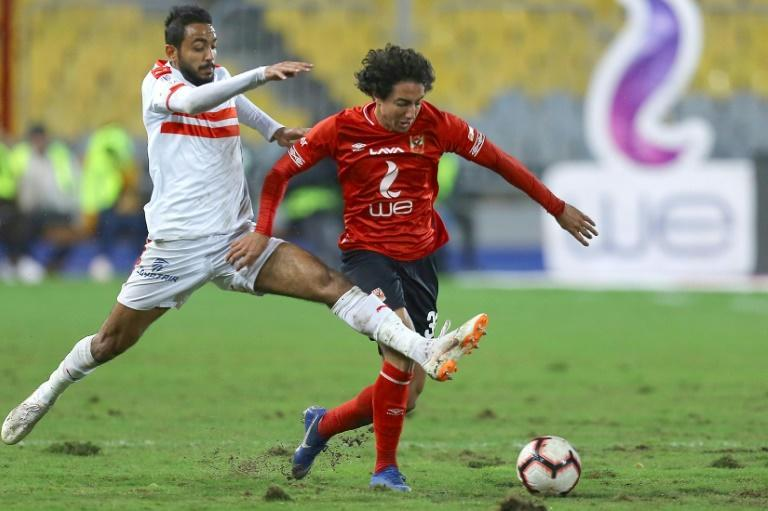 Mohamed Hany (R) scored the opening goal as Egyptian league leaders Al Ahly returned to action after a 150-day coronavirus-induced suspension with a 2-0 victory over ENPPI