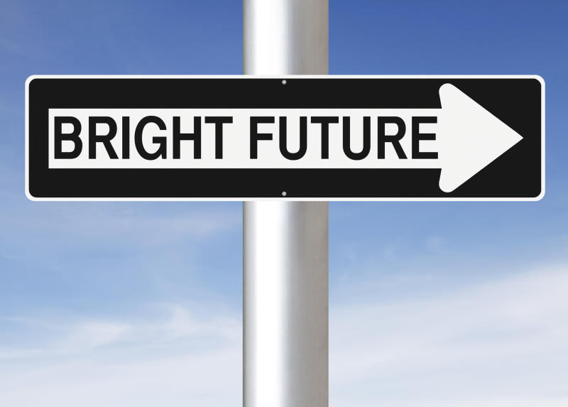 """Street sign with """"bright future"""" printed inside an arrow pointing right"""