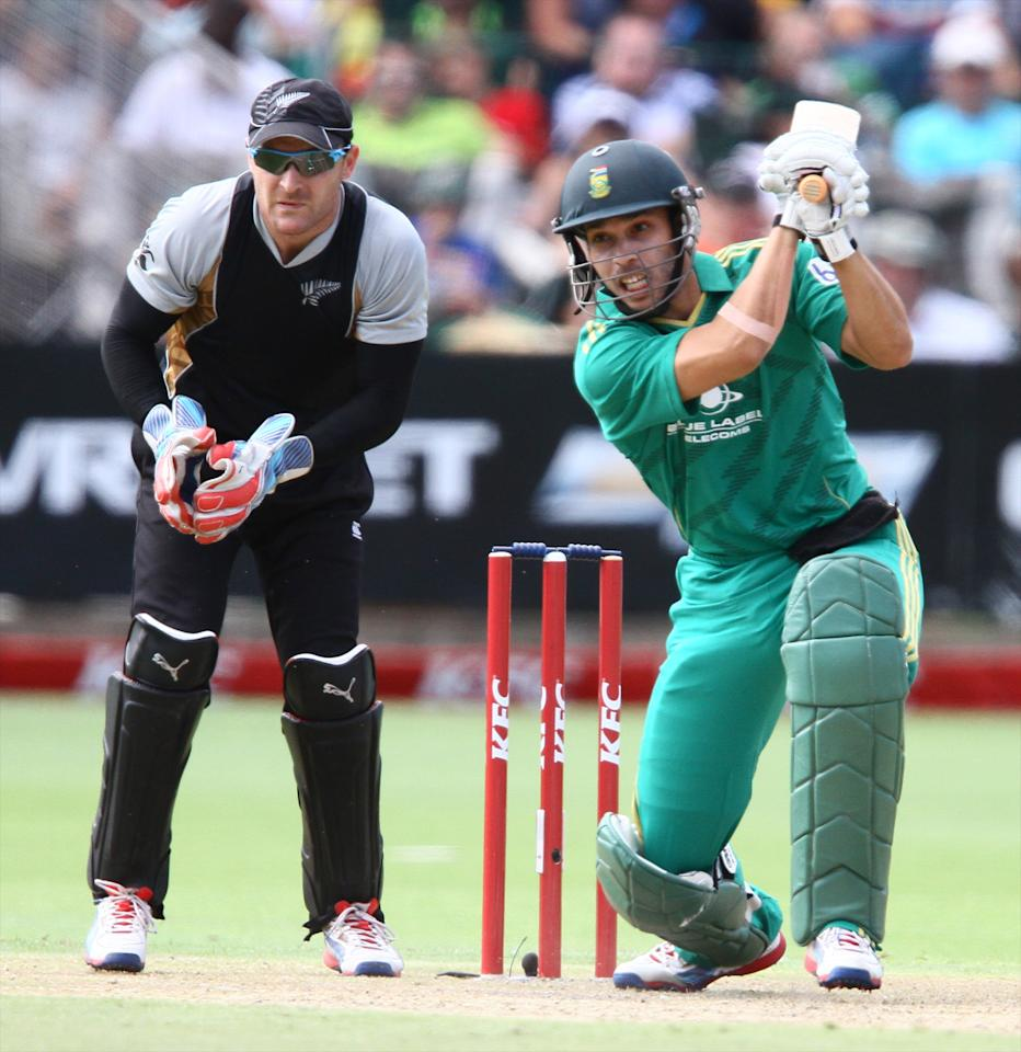 PORT ELIZABETH, SOUTH AFRICA - DECEMBER 26: Farhaan Behardien of South Africa and Brendon McCullum of New Zealand  during the 3rd T20 International match between South Africa and New Zealand at AXXESS St Georges on December 26, 2012 in Port Elizabeth, South Africa. (Photo by Richard Huggard / Gallo Images/Getty Images)