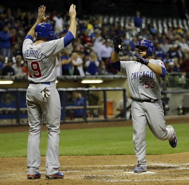 Chicago Cubs' Welington Castillo is congratulated at home by teammate Nate Schierholtz after Castillo hit a two-run home run during the seventh inning of a baseball game against the Milwaukee Brewers Tuesday, Sept. 17, 2013, in Milwaukee. (AP Photo/Morry Gash)