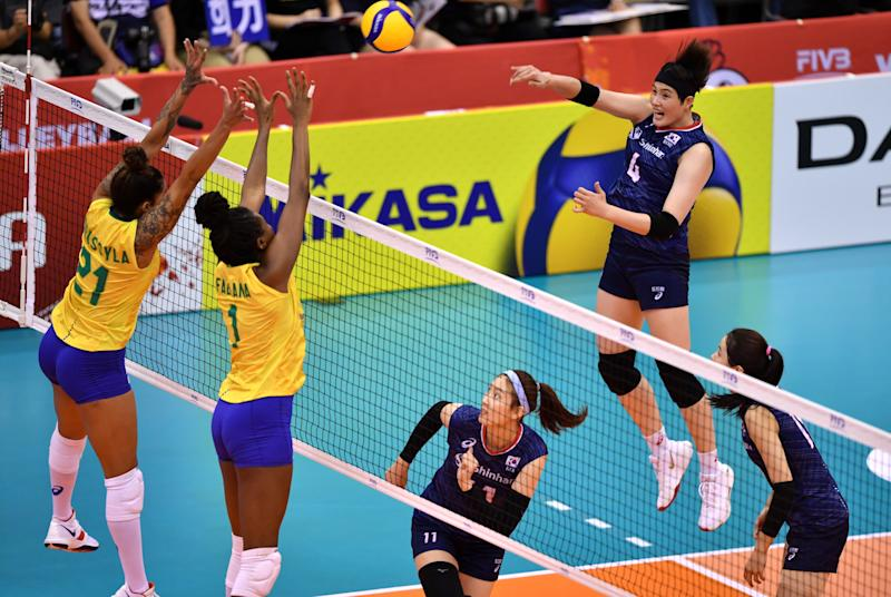 South Korea's Kim Jeejin (top R) spikes the ball against Brazil's Drussyla Costa (L) and Fabiana Claudino (2nd L) during a match of the FIVB Women's World Cup volleyball between South Korea and Brazil in Osaka on September 28, 2019. (Photo by Kazuhiro NOGI / AFP) (Photo credit should read KAZUHIRO NOGI/AFP via Getty Images)