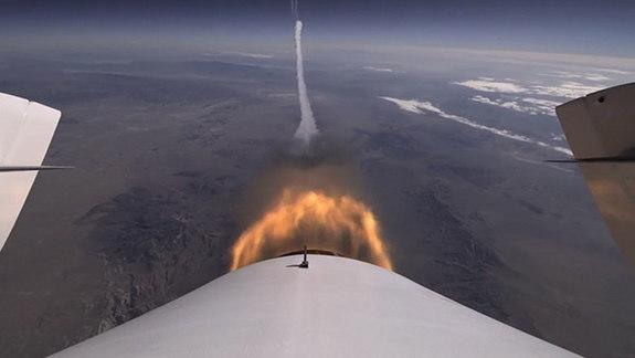 A camera mounted on Virgin Galactic's SpaceShipTwo shows shows the view behind the spacecraft as it took its second powered test flight over the Mojave Air and Space Port on Sept. 5, 2013.