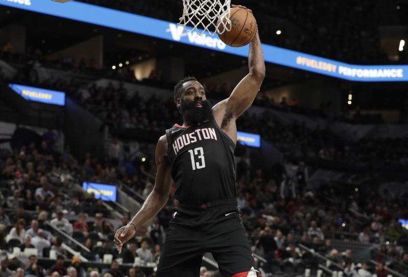 Houston Rockets guard James Harden (13) drives to the basket during the second half of an NBA basketball game against the San Antonio Spurs, in San Antonio, Tuesday, Dec. 3, 2019. San Antonio won 135-133 in double overtime. (AP Photo/Eric Gay)