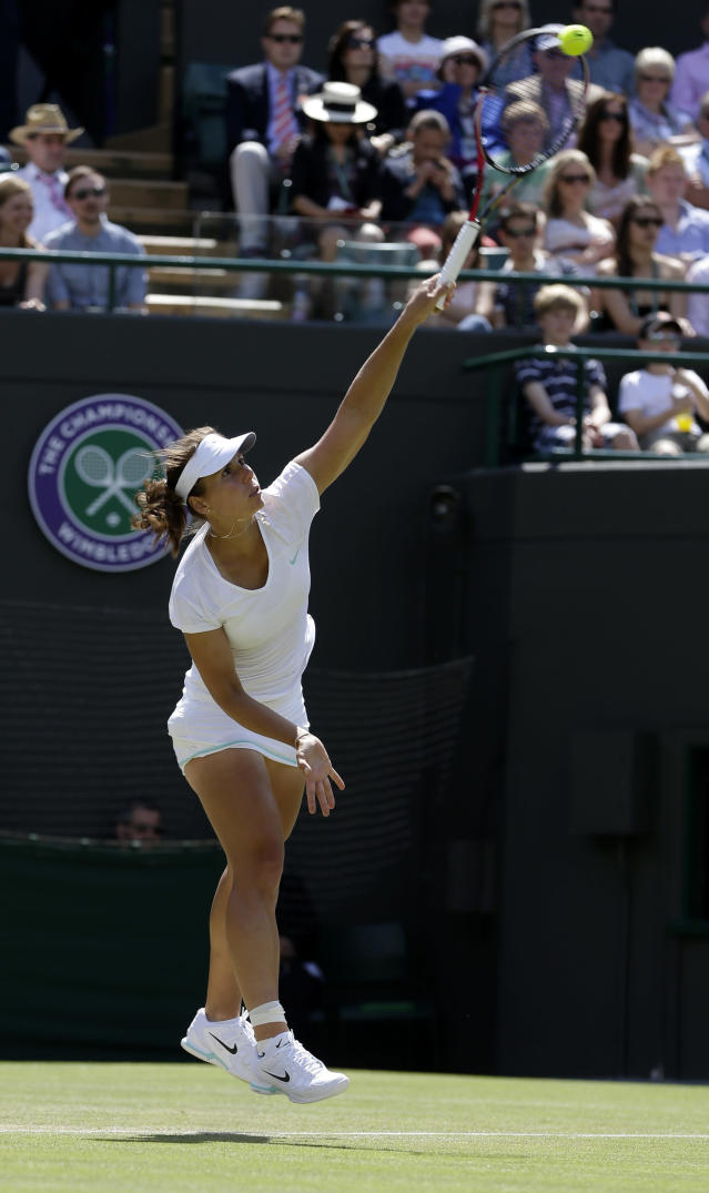 Varvara Lepchenko of the United States serves to Petra Kvitova of the Czech Republic during a third round women's singles match at the All England Lawn Tennis Championships at Wimbledon, England, Saturday, June 30, 2012. (AP Photo/Alastair Grant)