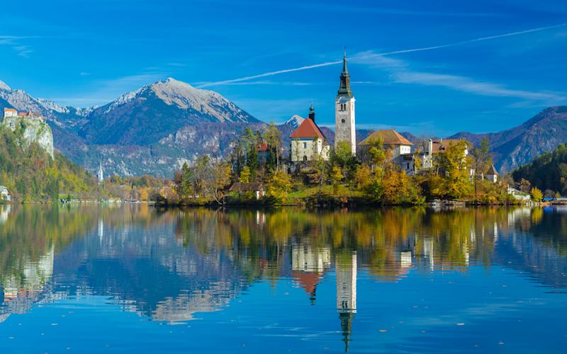 Lake Bled provides a beautiful backdrop for a hiking holiday - Credit: GETTY