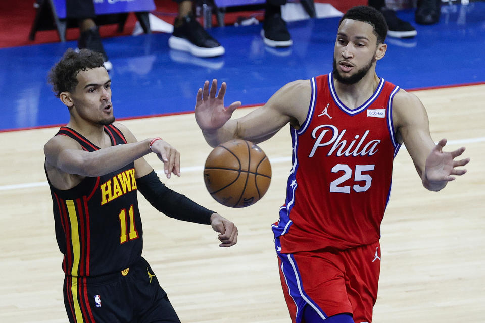 PHILADELPHIA, PENNSYLVANIA - JUNE 06: Trae Young #11 of the Atlanta Hawks passes past Ben Simmons #25 of the Philadelphia 76ers during the fourth quarter during Game One of the Eastern Conference second round series at Wells Fargo Center on June 06, 2021 in Philadelphia, Pennsylvania. NOTE TO USER: User expressly acknowledges and agrees that, by downloading and or using this photograph, User is consenting to the terms and conditions of the Getty Images License Agreement. (Photo by Tim Nwachukwu/Getty Images)